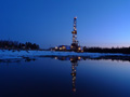 Production drilling rig at Lineynoye Pad #1 at night