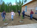 Tree planting @ Lineynoye Camp. CEO Dennis Francis (far left)